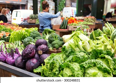 LONDON - JUN 12, 2015: Fresh vegetables in crates at a farmers market, London, UK. Borough market london, farmers market, local market, farmers local market, market gourmet, crates food, uk market.