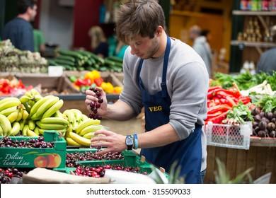 LONDON - JUN 12, 2015: Fresh vegetables in crates at a farmers market, London, UK.