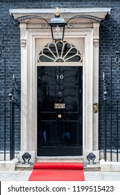 LONDON - JUN 16: Entrance door of 10 Downing Street in London on June 16, 2013. The street was built in the 1680s by Sir George Downing  and is now the residence of the Prime Minister.