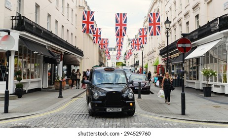 LONDON - JUN 16: Traffic makes its way along a road in the borough of Westminster on Jun 16, 2015 in London, UK. Westminster covers 8 sq miles in central London.