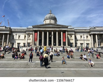 LONDON - JUN 6, 2018: Tourists enjoying the sun on the steps in front of the National Gallery