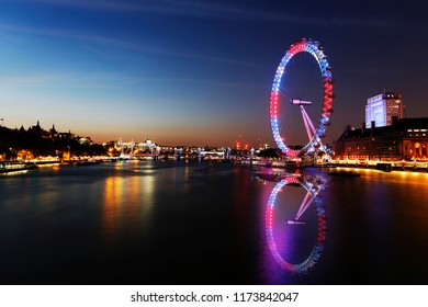 LONDON - JUNE 11: Night View of London Skyline include London-Eye on June 11, 2015, London, UK. London Eye is a famous tourist attraction at a height of 135 metres, the biggest Ferris wheel in Europe.