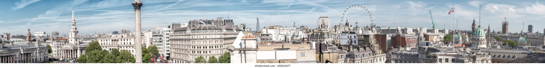 LONDON - JUNE 12, 2015: Panoramic view of the city from Trafalgar Square rooftop. London attracts 50 million tourists annually.