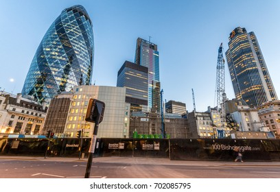 LONDON - JUNE 13, 2015: The Gherkin at sunset. The building is a commercial skyscraper in London's primary financial district, the City of London.