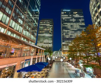 LONDON - JUNE 14, 2015: Lights of Canary Wharf buildings at night. Canary Wharf is the city financial district.