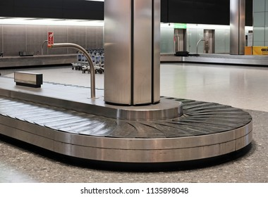 LONDON - JUNE 14, 2018: Empty baggage carousel conveyor at the baggage collection hall in Terminal 5, Heathrow Airport, London. Heathrow is the main airport serving London.