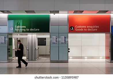 LONDON - JUNE 14, 2018: A passenger at the customs declaration gate in Terminal 5, Heathrow Airport, London. Heathrow is the main airport serving London.