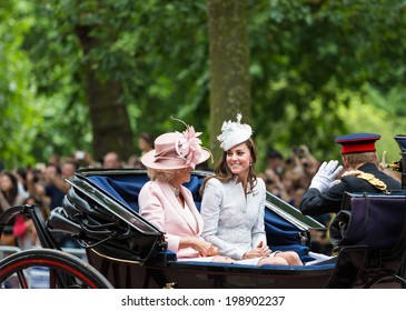 LONDON - JUNE 14: Kate Middleton and Camilla Rosemary seat on the Coach at Queen's Birthday Parade, also known as Trooping the Colour, on June 14, 2014 in London, England.