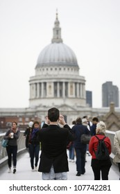 LONDON - JUNE 14: Tourist taking pictures at St Paul's Cathedral on June 14, 2012 in London, UK, founded in 604, completed in 1708, 111m high, locates at the top of Ludgate Hill, City of London.