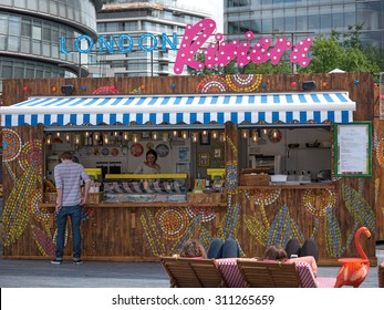 LONDON - JUNE 16, 2015: People enjoying at London Riviera, a pop-up food and drink experience outlet, quite popular among people, a good place to relax.
