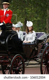 LONDON - JUNE 16: Catherine, Duchess of Cambridge and Camilla, Duchess of Cornwall seat on the Royal Coach at Queen's Birthday Parade on June 16, 2012 in London, UK.