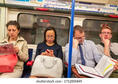 LONDON - JUNE 17, 2014: Commuters travelling home from work on the London Underground