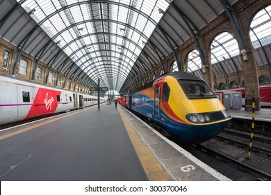 LONDON - JUNE 17, 2015: Interior view of King's Cross railway station, a major London railway terminus which opened in 1852 on the northern edge of central London.