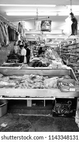 LONDON - JUNE 18, 2018: Butchers in their meat shop in Brixton Market in Electric Avenue, Brixton,  London. The market St built in the 1880s is famous for selling a range of Afro-Caribbean products.
