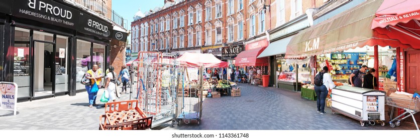 LONDON - JUNE 18, 2018: Panoramic view of Brixton Market in Electric Avenue, Brixton, South London. The market street built in the 1880s was the first market street to be lit by electricity.