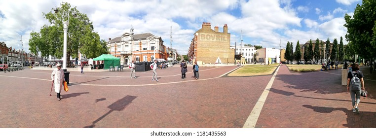 LONDON - JUNE 18, 2018: Panoramic view of Windrush Square on Effra Road, London. The square is an open public space renamed to recognise the contribution of African Caribbean community to the area.
