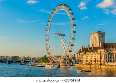 LONDON - JUNE 2, 2013: View of the London Eye at sunset. London Eye (135 m tall, diameter of 120 m) - a famous tourist attraction over river Thames in the capital city London.