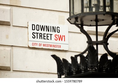 LONDON - JUNE 2011: A road sign for Downing Street, where the residence of the Prime Minister is located, hangs on the wall of a building in the Whitehall political center.
