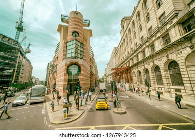 LONDON - JUNE 2015: Tourists and traffic along city streets. The city attracts 30 million people annually.