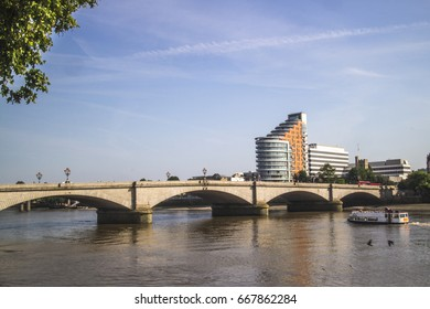 LONDON- JUNE 2017: Putney Bridge from the Thames path on the north side of the River Thames. Road and pedestrian traffic bridge that links Putney to Fulham in West London.