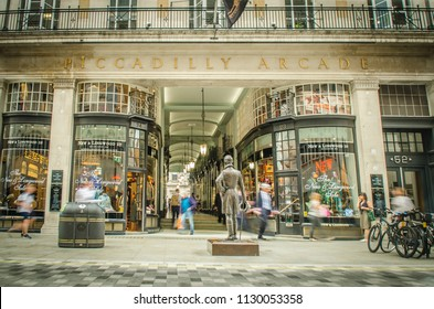 LONDON- JUNE, 2018: Motion blurred view of Piccadilly Arcade, an upmarket Victorian shopping arcade in St James / Mayfair area of London