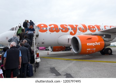 LONDON - JUNE, 2018: Passengers boarding on Easy Jet airplane at Gatwick Airport.