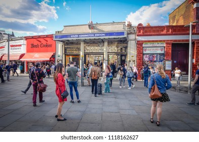 LONDON- JUNE, 2018: South Kensington Underground station exterior on with many people on a sunny day