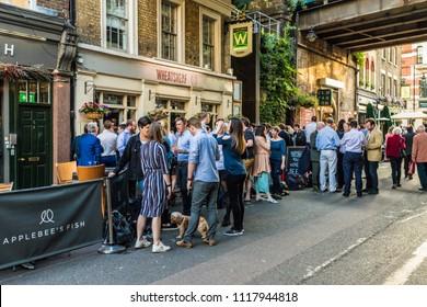 London. June 2018. A view of people enjoying an after work drink in the wheatsheaf pub in London.