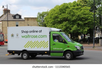 London, June 2018 - a Waitrose branded van used to deliver online grocery shopping seen driving near Battersea, South West London