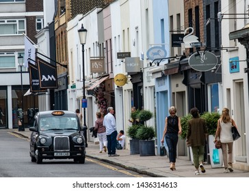 LONDON- JUNE, 2019: An attractive street of upmarket fashion boutique shops in South Kensington / Knightsbridge area of London