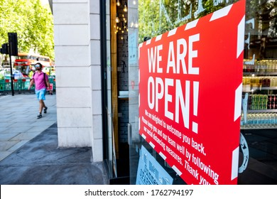 LONDON- JUNE, 2020:  'We Are Open'  sign on high street shop window in London, as businesses start to open after the Coronavirus lockdown is lifted