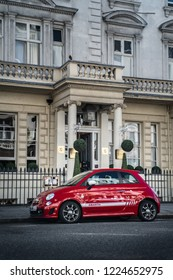 London - June 21, 2018: Fiat 500C Abarth 595 in the street of Victoria. The 595 is a tuned-up version of the original compact hatchback.