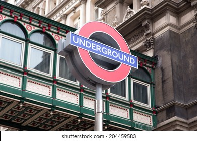 LONDON - JUNE 21: Close up of a traditional station sign for the London Underground transportation systems on June 21, 2014 in London. The sign was first used in 1908.