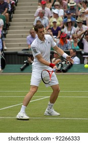 LONDON - JUNE 24: Andy Murray of Scotland returns ball during second round match against Jarkko Nieminen of Finland at Wimbledon in London, England on June 24, 2010