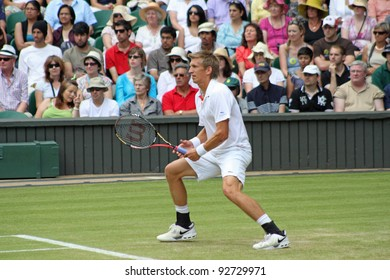 LONDON - JUNE 24: Jarkko Nieminen of Finland returns ball during second round match against Andy Murray of Scotland at Wimbledon in London, England on June 24, 2010