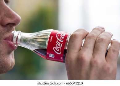 LONDON - JUNE 24: A man drinking the famous beverage Coca Cola from glass bottle in London on June 24. 2017 in UK