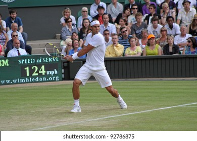 LONDON - JUNE 24: Rafael Nadal of Spain returns ball during second round match against Robin Haase of the Netherlands at Wimbledon in London, England on June 24, 2010