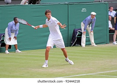 LONDON - JUNE 24: Robin Haase of the Netherlands returns ball during second round match against Rafael Nadal of Spain at Wimbledon in London, England on June 24, 2010