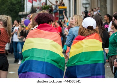 LONDON, JUNE 25, 2016: LGBT Gay Pride Parade Two Woman Wrapped In Rainbow Flags