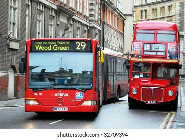 LONDON - JUNE 26: An articulated bus (L) passes one 50 years its senior on June 26, 2009. The Mayor has indicated that articulated buses will be replaced with double deckers by the end of 2011.