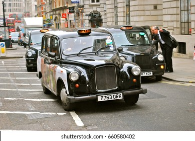 LONDON - JUNE 26 : A Taxi or 'Black Cab' on June 26, 2014 in London, UK. All London cabs undergo a strict annual mechanical test before they are allowed to ply for hire in London, June 26, 2012