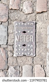 LONDON - JUNE 28, 2018: Facade of Thames Water meter cover in Covent Garden, London. Thames Water Utilities Ltd is the monopoly private utility company supplying water and waste treatment in London.