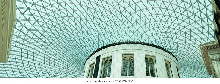 LONDON - JUNE 28, 2018: Panoramic view of the British Museum Great Court glass dome in Great Russell St, UK. The Museum inner courtyard is the largest covered public square in Europe.