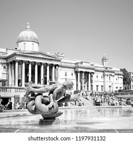 LONDON - JUNE 29, 2018: Mermaids and Triton sculptures in Eastern Trafalgar Square fountain, Trafalgar Square, London. The memorial sculptures were added to the fountain in 1948.