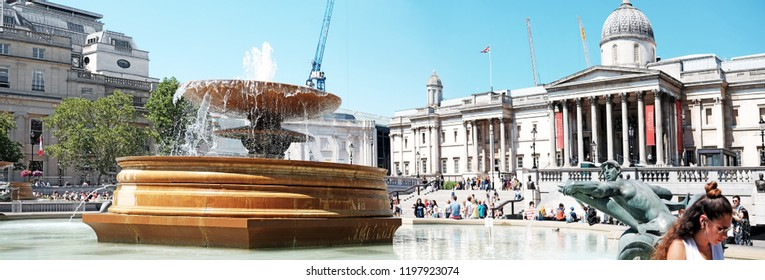 LONDON - JUNE 29, 2018: Western Trafalgar Square fountain in Trafalgar Square, London. The fountain was build in 1845 to reduced the open space for public gatherings and the risk of riotous assembly.