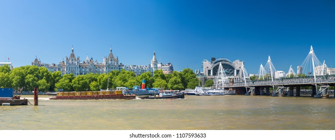 LONDON - JUNE 30, 2015: Panoramic view of Hungerford Bridge on a beautiful summer day. London attracts 30 million people annually.