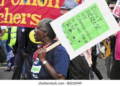 LONDON - JUNE 30; An unidentified African American woman protests against government proposed pension reform during a march organised by unions in London on June 30, 2011
