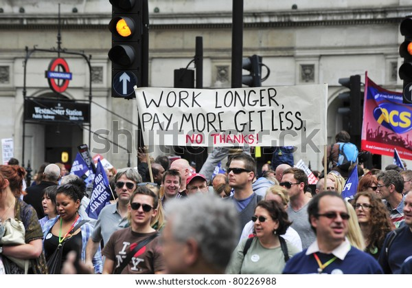 LONDON - JUNE 30; Unidentified members of trade unions march in protest against spending cuts and pension reform. The demonstration was organised by various trade unions in London on June 30, 2011