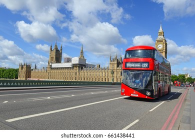 LONDON JUNE 4 2017. After a horrific and cowardly terrorist attack on London Bridge the night before, tourists and red double decker buses fill the street near Big Ben and Palace of Westminster.