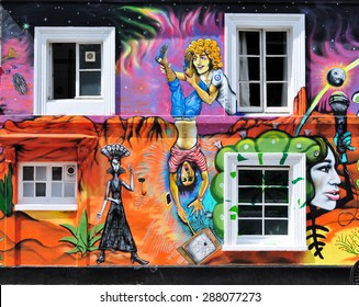 LONDON - JUNE 6, 2015. Part of temporary spray painted and printed mural by artist Morganico on the facade of the Chelsea Arts Club in the Royal Borough of Kensington and Chelsea, London, UK.